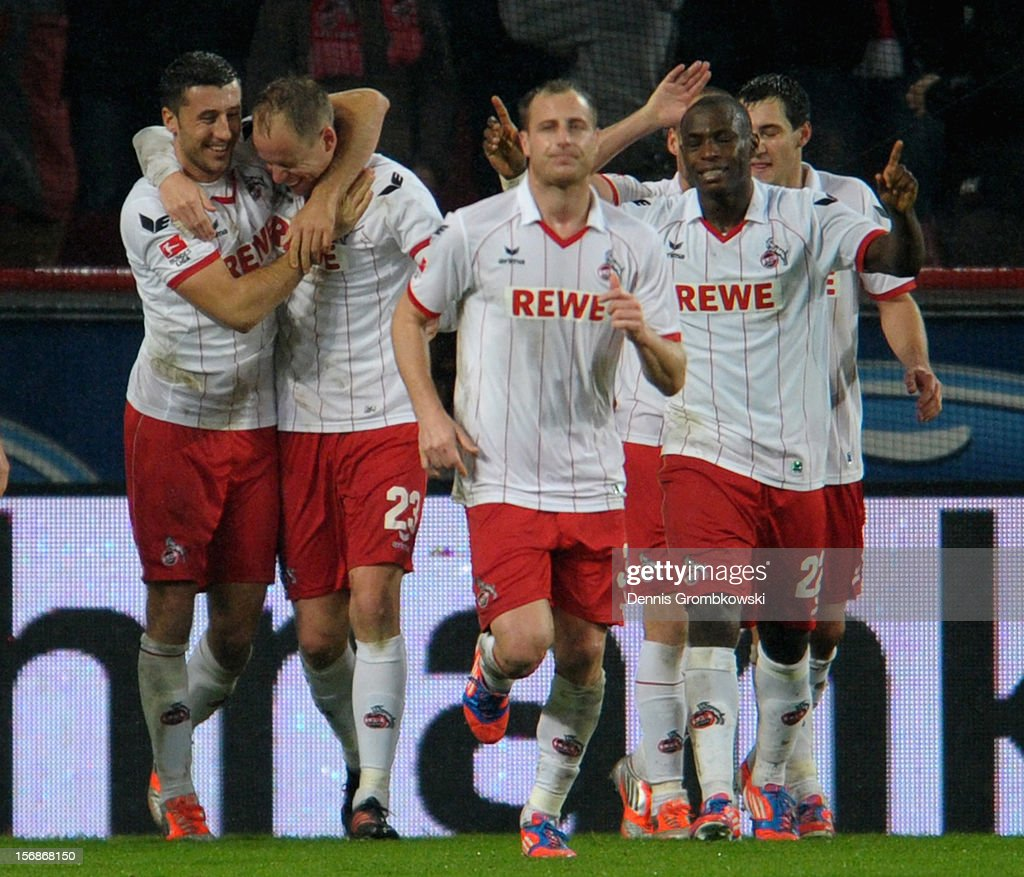 Kevin McKenna of Cologne celebrates with teammates after heading his team's second goal during the Second Bundesliga match between 1. FC Koeln and VfL Bochum at RheinEnergieStadion on November 23, 2012 in Cologne, Germany.