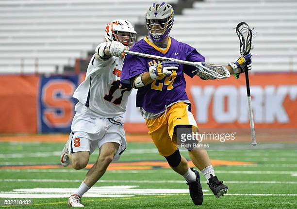 Kevin McNally of the Albany Great Danes runs with the ball as Dylan Donahue of the Syracuse Orange defends during the second quarter at the Carrier...