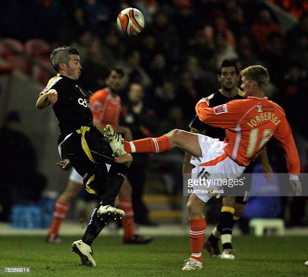 Kevin McNaughton of Cardiff and Claus Jorgensen of Blackpool challenge for the ball during the CocaCola Championship match between Blackpool and...
