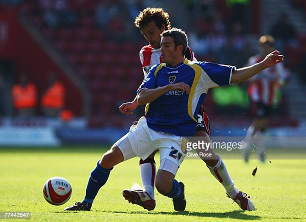 Kevin McNaughton of Cardiff City is challenged by Inigo Idiakez of Southampton during the CocaCola Championship match between Southampton and Cardiff...
