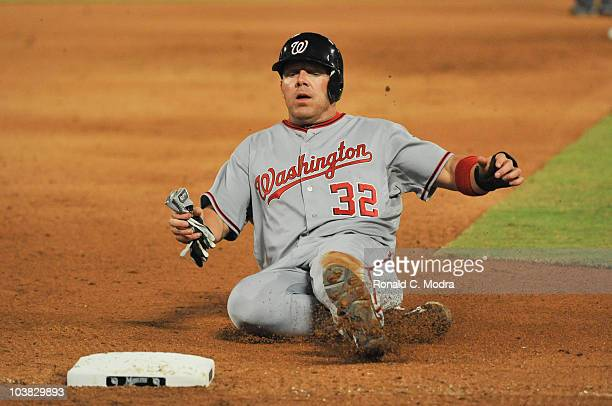 Kevin Mench of the Washington Nationals slides into third base during a MLB game against the Florida Marlins at Sun Life Stadium on September 1 2010...