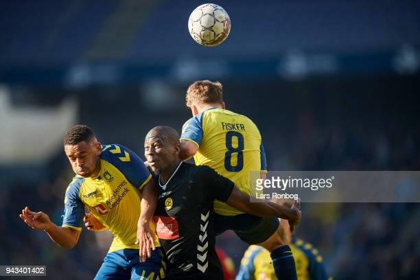 Kevin Mensah of Brondby IF Delphin Tshiembe of AC Horsens and Kasper Fisker of Brondby IF compete for the ball during the Danish Alka Superliga match...