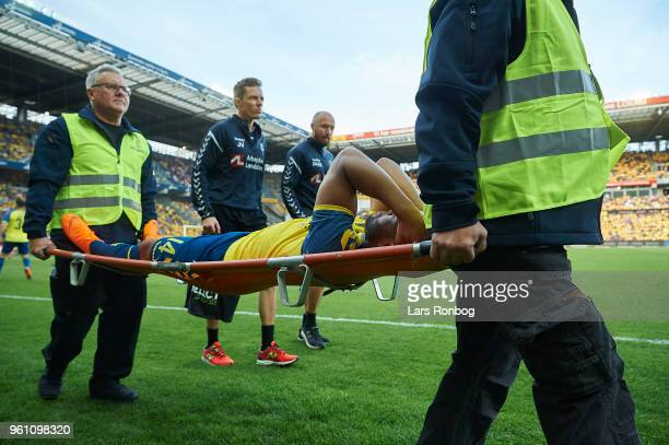 Kevin Mensah of Brondby IF leaving the pitch injured on a stretcher during the Danish Alka Superliga match between Brondby IF and AaB Aalborg at...