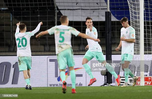 Kevin Möhwald of Bremen celebrate with his team mates after he scores his team's 2nd goal during the Bundesliga match between DSC Arminia Bielefeld...