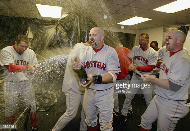 Kevin Millar of the Boston Red Sox celebrates the victory over the Oakland A's in Game 5 of the 2003 American League Divisional Series on October 6...