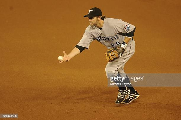 0d4f3e1aa70 Kevin Millar of the Toronto Blue Jays fields a ground ball during a baseball  game against