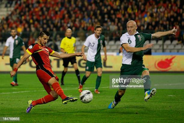 Kevin Mirallas of Belgium shoots on goal as James Collins of Wales attempts the block during the FIFA 2014 World Cup Qualifying Group A match between...