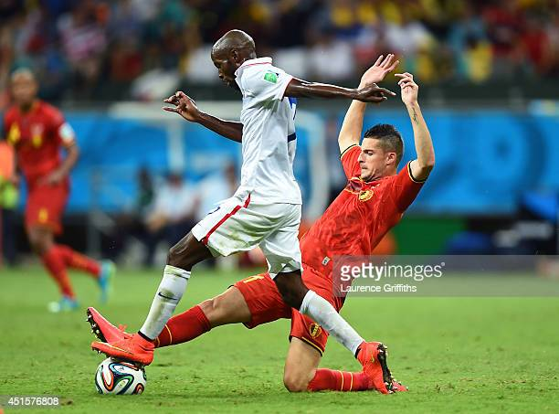 Kevin Mirallas of Belgium tackles DaMarcus Beasley of the United States during the 2014 FIFA World Cup Brazil Round of 16 match between Belgium and...