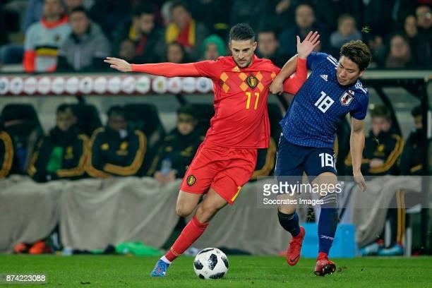 Kevin Mirallas of Belgium Takuma Asano of Japan during the International Friendly match between Belgium v Japan at the Jan Breydel Stadium on...
