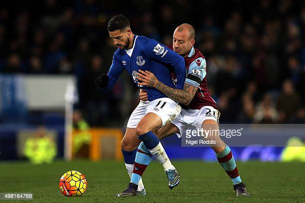 Kevin Mirallas of Everton and Alan Hutton of Aston Villa compete for the ball during the Barclays Premier League match between Everton and Aston...