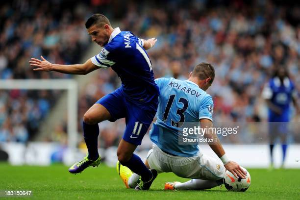 Kevin Mirallas of Everton and Aleksandr Kolarov of Manchester City compete for the ball during the Barclays Premier League match between Manchester...