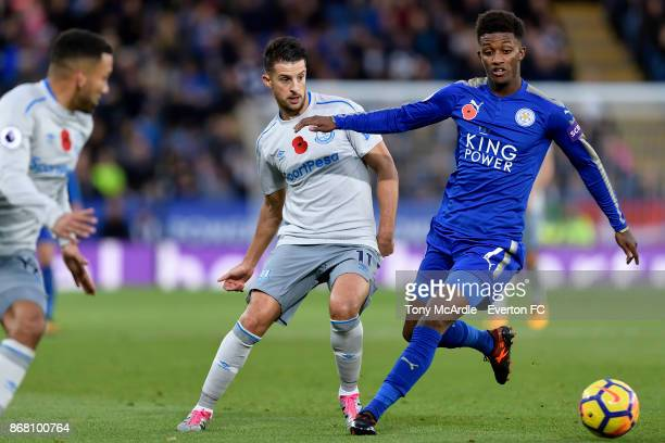 Kevin Mirallas of Everton and Demarai Gray challenge for the ball during the Premier League match between Leicester City and Everton at the King...