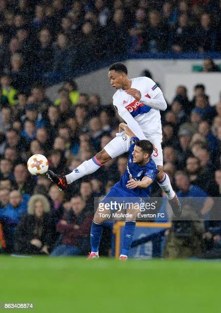 Kevin Mirallas of Everton and Kenny Tete challenge for the ball during the UEFA Europa League group E match between Everton and Olympique Lyon at...