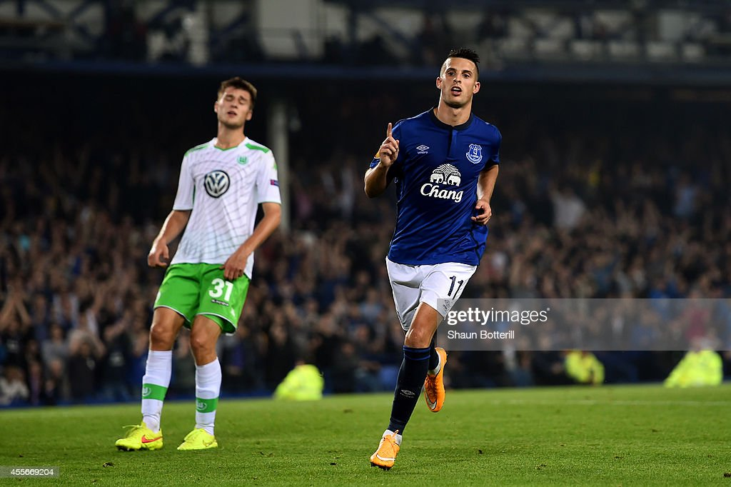 Kevin Mirallas of Everton celebrates after scoring his team's fourth goal whilst a dejected Robin Knoche of VfL Wolfsburg reacts during the UEFA Europa League Group H match between Everton and VFL Wolfsburg on September 18, 2014 in Liverpool, United Kingdom.