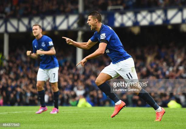 Kevin Mirallas of Everton celebrates scoring his goal during the Barclays Premier League match between Everton and Chelsea at Goodison Park on August...