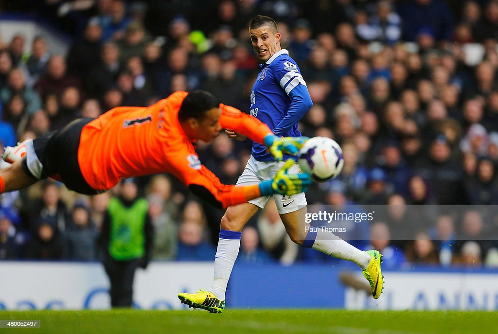 Kevin Mirallas of Everton has his shot saved by Michel Vorm of Swansea City during the Barclays Premier League match between Everton and Swansea City at Goodison Park on March 22, 2014 in Liverpool, England.