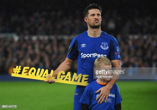 Kevin Mirallas of Everton holds the #equalgame banner prior to the UEFA Europa League Group E match between Everton FC and Olympique Lyon at Goodison...
