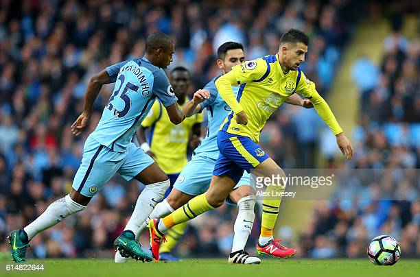 Kevin Mirallas of Everton is chased by Fernandinho and Ilkay Gundogan of Manchester City during the Premier League match between Manchester City and...