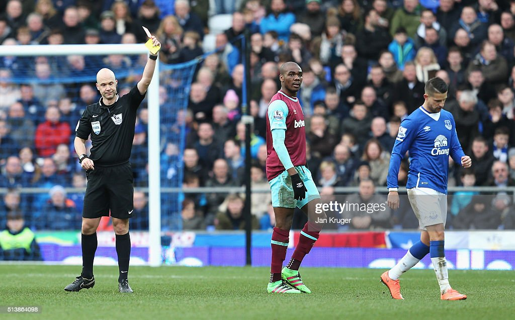 Kevin Mirallas (R) of Everton is shown a red card by referee Anthony Taylor (L) during the Barclays Premier League match between Everton and West Ham United at Goodison Park on March 5, 2016 in Liverpool, England.