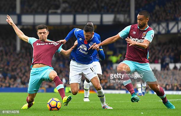 Kevin Mirallas of Everton is tackled by Aaron Cresswell of West Ham United and Winston Reid of West Ham United during the Premier League match...