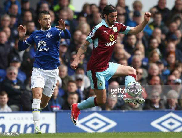 Kevin Mirallas of Everton puts pressure on George Boyd of Burnley during the Premier League match between Everton and Burnley at Goodison Park on...