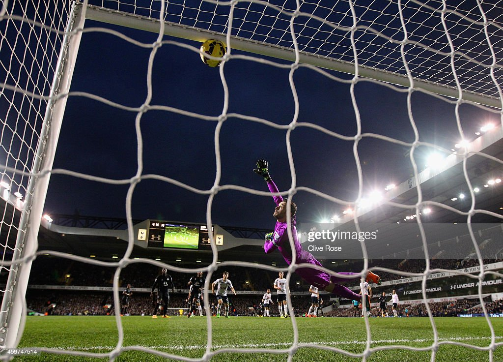 Kevin Mirallas of Everton scores the opening goal past Hugo Lloris of Spurs during the Barclays Premier League match between Tottenham Hotspur and Everton at White Hart Lane on November 30, 2014 in London, England.