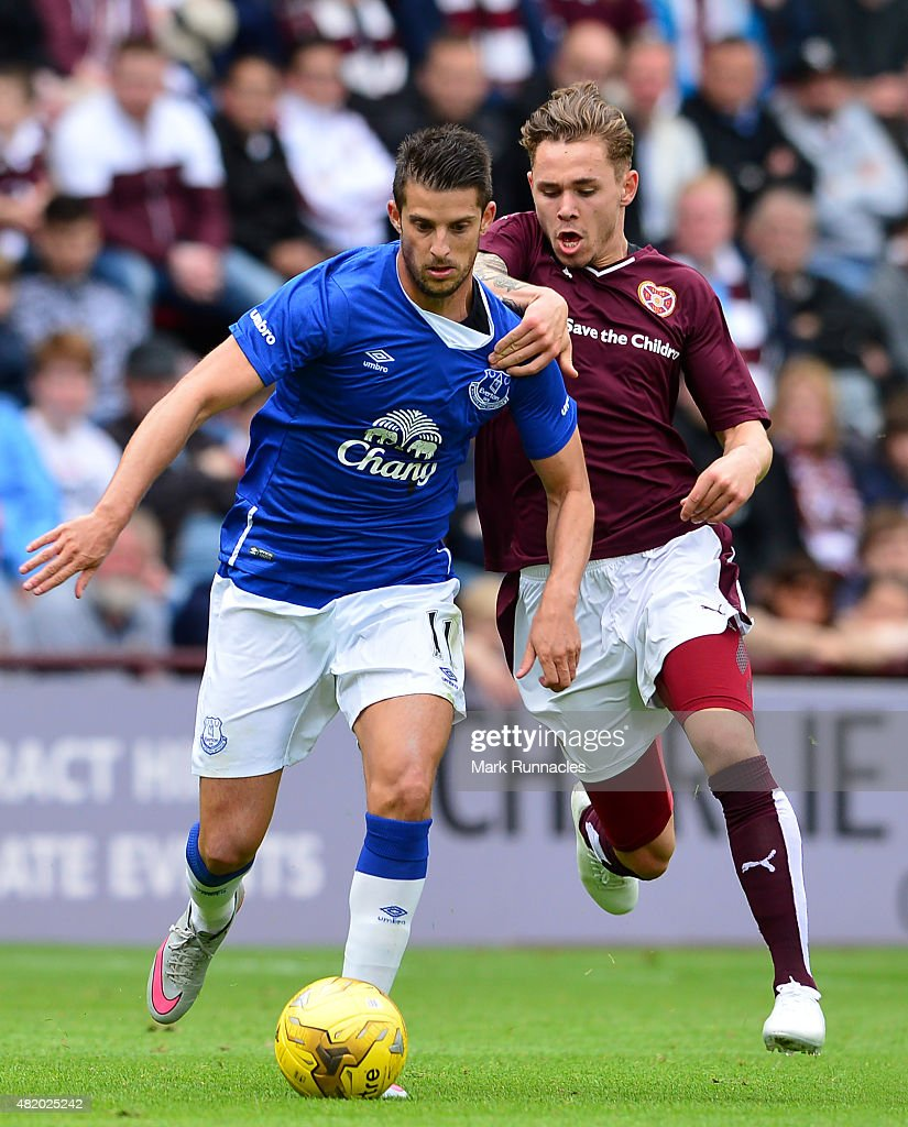 Kevin Mirallas of Everton takes on Sam Nicolson of Hearts during a pre season friendly match between Heart of Midlothian and Everton FC at Tynecastle Stadium on July 26, 2015 in Edinburgh, Scotland.