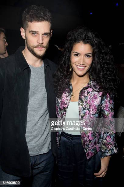 Kevin Mishel and Sabrina Ouazani attend the HM Studio show as part of the Paris Fashion Week on March 1 2017 in Paris France