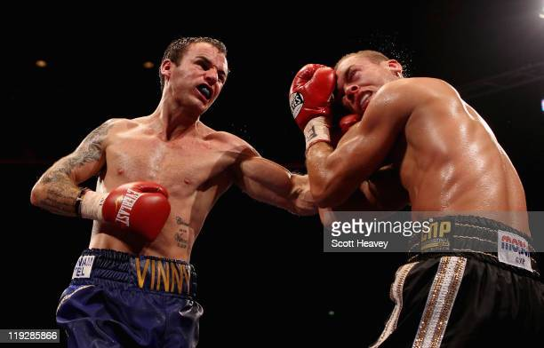 Kevin Mitchell connects with John Murray during the vacant WBO Inter-Continental Lightweight Championship bout at Echo Arena on July 16, 2011 in...