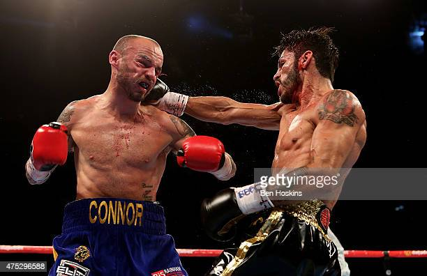 Kevin Mitchell of England and Jorge Linares of Venezuela exchange blows during their WBC World Lightweight Championship bout at The O2 Arena on May...