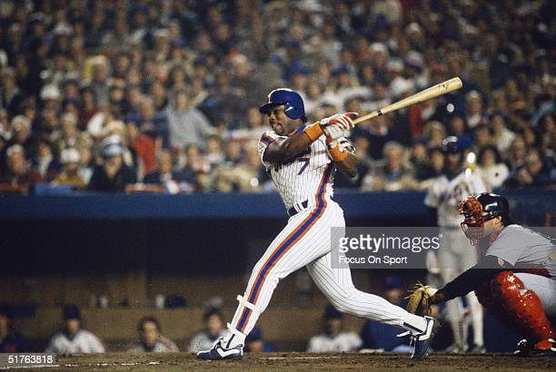 Kevin Mitchell of the New York Mets takes a big cut during the World Series against the Boston Red Sox at Shea Stadium on October 1986 in Flushing...
