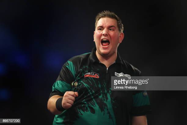 Kevin Münch of Germany celebrates after winning his first round match against Adrian Lewis of England on day six of the 2018 William Hill PDC World...