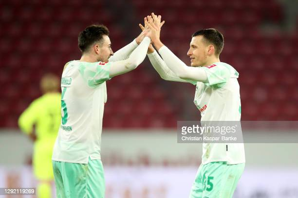 Kevin Moehwald and Maximilian Eggestein of Werder Bremen celebrate after the Bundesliga match between 1. FSV Mainz 05 and SV Werder Bremen at Opel...