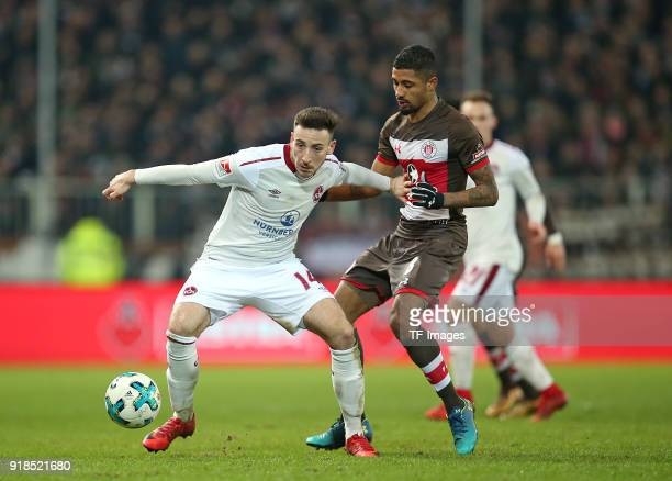 Kevin Moehwald of Nuernberg and Jeremy Dudziak of St Pauli battle for the ball during the Second Bundesliga match between FC St Pauli and 1 FC...