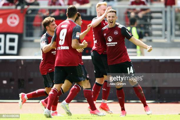 Kevin Moehwald of Nuernberg celebrates his team's third goal with team mates during the Second Bundesliga match between 1 FC Nuernberg and 1 FC...