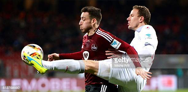Kevin Moehwald of Nuernberg is challenged by Marcel Gaus of Kaiserslautern during the Second Bundesliga match between 1 FC Nuernberg and 1 FC...