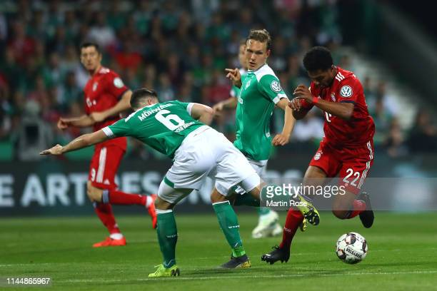 Kevin Moehwald of Werder Bremen Ludwig Augustinsson of Werder Bremen and Serge Gnabry of Bayern Munich battle for possession during the DFB Cup semi...