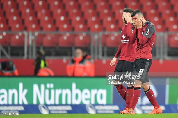 Kevin Moehwaldand Mikael Ishak of 1FC Nuernberg gesture after the final whistle during the Second Bundesliga match between 1 FC Nuernberg and FC...
