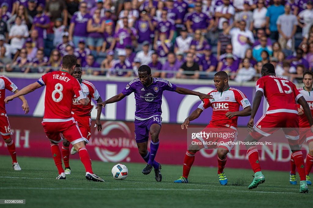 Kevin Molino #18 of the Orlando City Lions defends the ball against the New England Revolution at the Citrus Bowl in Orlando, Florida on April 17, 2016.