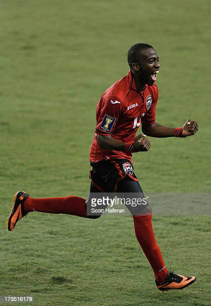 Kevin Molino of Trinidad & Tobago celebrates a second half goal against Honduras during the CONCACAF Gold Cup game at BBVA Compass Stadium on July...