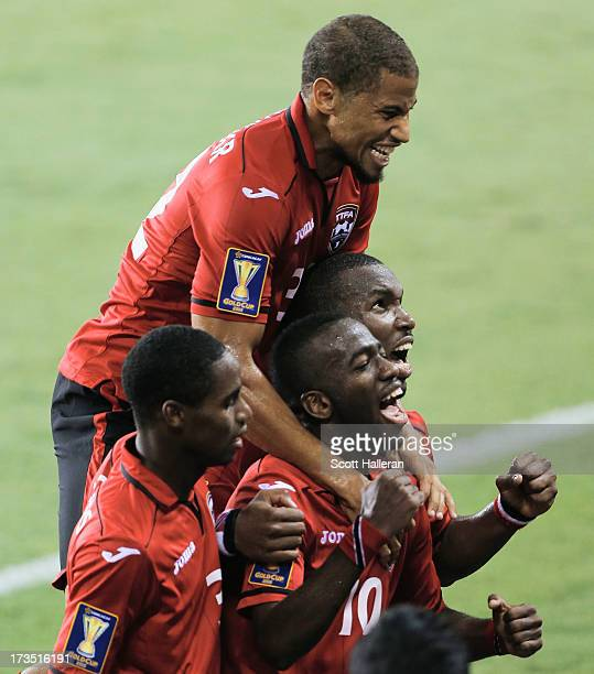 Kevin Molino of Trinidad & Tobago celebrates a second half goal against Honduras with his teammates during the CONCACAF Gold Cup game at BBVA Compass...