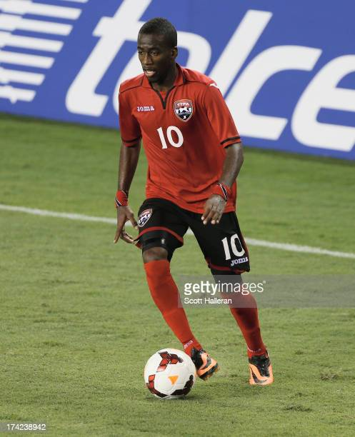 Kevin Molino of Trinidad & Tobago plays a balll against Honduras during the CONCACAF Gold Cup game at BBVA Compass Stadium on July 15, 2013 in...