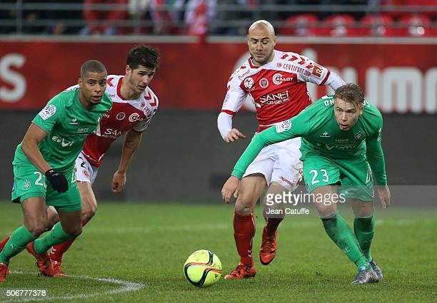 Kevin MonnetPaquet of SaintEtienne Anthony Weber and Jaba Kankava of Reims Alexander Soderlund of SaintEtienne in action during the French Ligue 1...