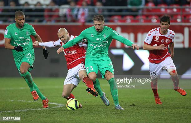 Kevin MonnetPaquet of SaintEtienne Jaba Kankava of Reims Alexander Soderlund of SaintEtienne Anthony Weber of Reims in action during the French Ligue...