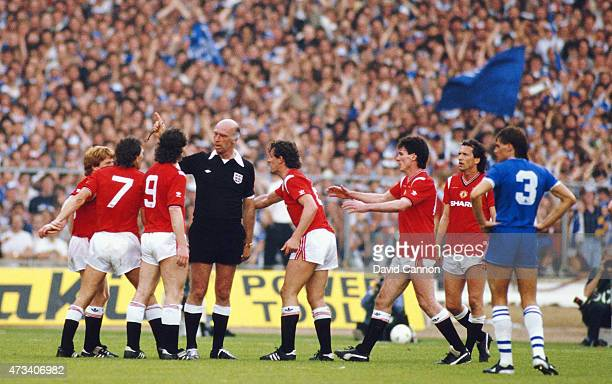 Kevin Moran of Manchester United is sent off by referee Peter Willis becoming the first player to be sent off in an FA Cup final as United players...