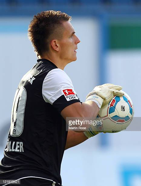 Kevin Mueller, goalkeeper of Rostock holds the ball during the Second Bundesliga match between FC Hansa Rostock and Alemannia Aachen at DKB Arena on...