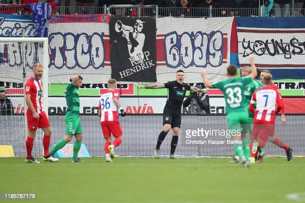 Kevin Mueller of 1.FC Heidenheim reacts after he saves the penalty shot of Maximilian Wittek of SpVgg Greuther Fürth during the Second Bundesliga...