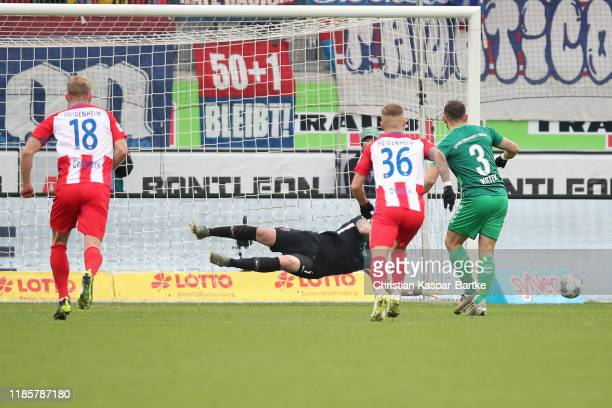 Kevin Mueller of 1.FC Heidenheim saves the penalty shot of Maximilian Wittek of SpVgg Greuther Fürth during the Second Bundesliga match between 1. FC...