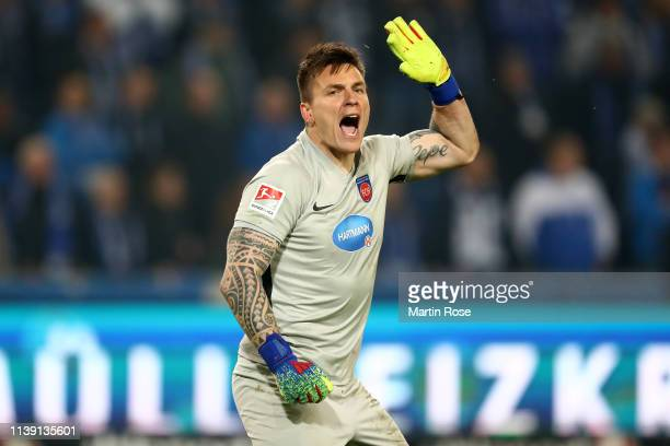 Kevin Muller of 1.FC Heidenheim celebrates after saving a penalty during the Second Bundesliga match between 1. FC Magdeburg and 1. FC Heidenheim...