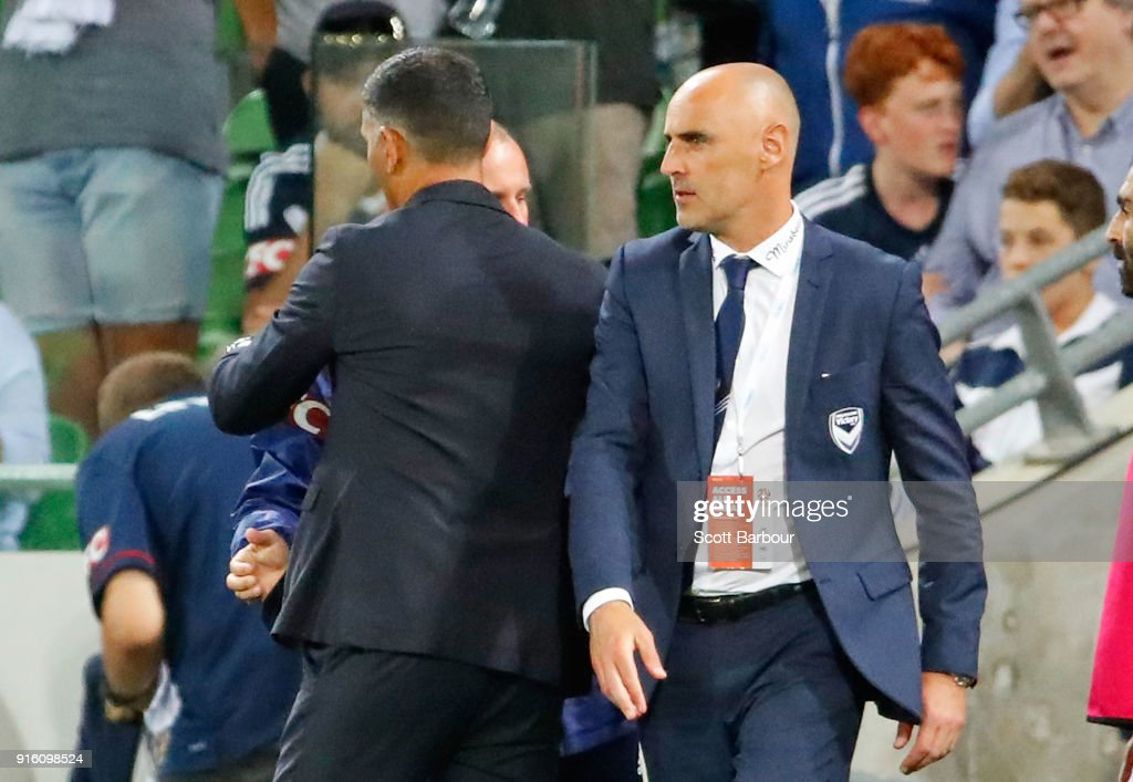Kevin Muscat, coach of the Victory reacts after shaking hands with Roar coach John Aloisi during the round 20 A-League match between the Melbourne Victory and the Brisbane Roar at AAMI Park on February 9, 2018 in Melbourne, Australia.